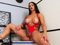 Busty  latina Pink Pinheiro masturbates her shecock on bed