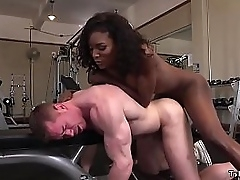 Big pair and big ass dark-skinned tranny Natassia Dreams jumps in the sky dude in front gym and now pounds his ass