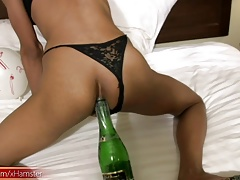 Ladyboy sticks  bottle in taut ass and eats cock
